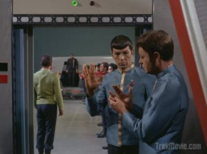 Spock shows McCoy how to do the Vulcan salute