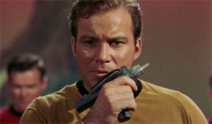 Kirk licks a phaser pistol, apparently?