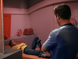 Kirk reclines, smugly.