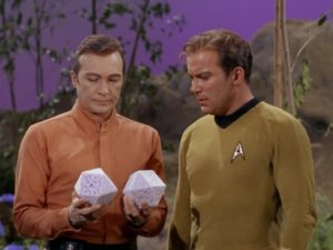 Rojan shows Kirk the pumice-stone d20s that were once two members of his crew.