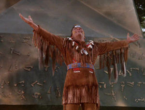 Kirk in a Native American costume that exceeds the definition of the word stereotypical.