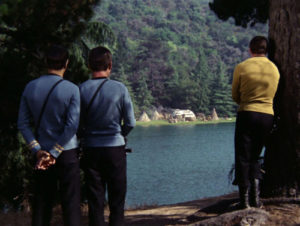 Kirk, Spock and Bones across the lake from the village.