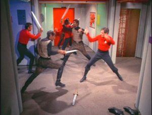 Klingons and the Federation crew fighting with swords.