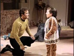 Kirk kneels to reassure Alexander, who is righteously pissed.