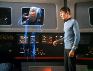 A phased-out Kirk floating on the bridge.