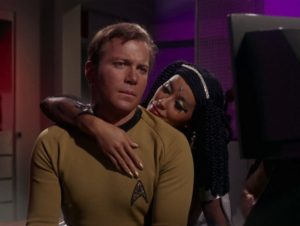 Elaan caresses Kirk after whammying him with her magical tears. Yes. For real.