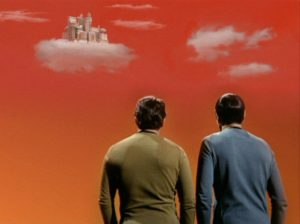 Kirk and Spock look up at the city of Stratos, nestled in a cloud.