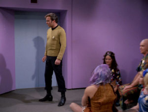 Kirk turns away from the space-hippies staging a sit-in in his transporter room, to collect himself