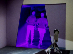 Spock and Bones go all glowy and purple as they pass through the portal