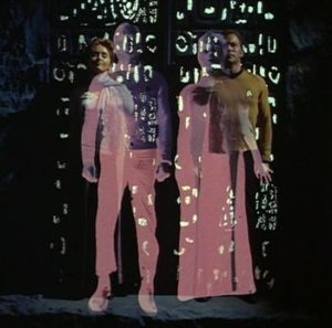 Kirk and Janice are swapped using the alien machine.
