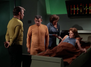 Nurse Chapel and a bunch of men stand over a Janice restrained in a sickbay bed. Problematic? Hell yes.