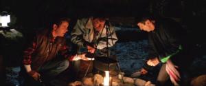 Kirk, Bones and Spock around a campfire on Earth.