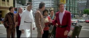 The crew standing in the middle of 1980s San Francisco. Left to right: Chekov, Scotty, Spock, Bones, Uhura, Sulu, Kirk.